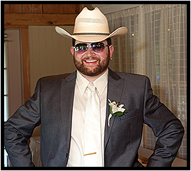 Groom Posting with Sunglasses and Cowboy Hat